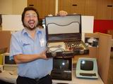 The ever zany Hans Franke shows off a briefcase computer of some sort.